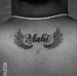 Neck back tattoo.jpg