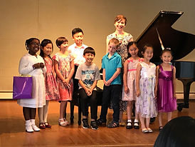 Candace and 9 of her students gather at the piano for a photo after the June 2017 recital performance.