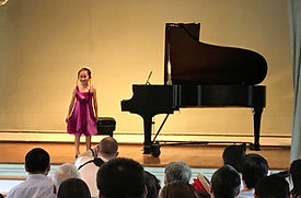 Iris smiles as she delivers her curtsey after her performance after the Juen 2017 recital.
