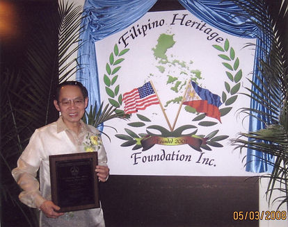 Bayani holding plaque for American Achie