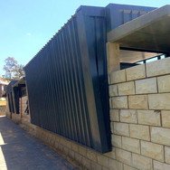 Corrugated iron with sandstone