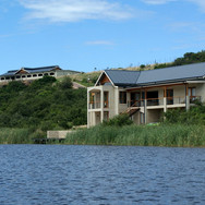 House and stables from lake