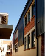 Alley between buildings east- note the window module