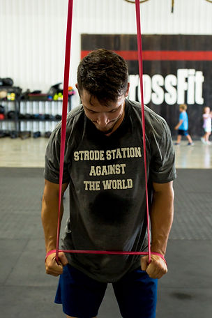 Coach Ryan Scott executing a banded pushdown at CrossFit Strode Station.