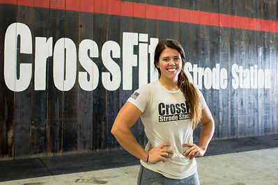 Coach Jocelyn smiling for the camera at CrossFit Strode Station.