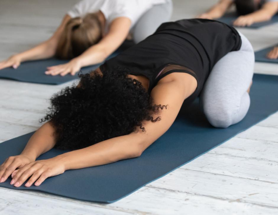 African American woman, yoga, child pose, yoga class