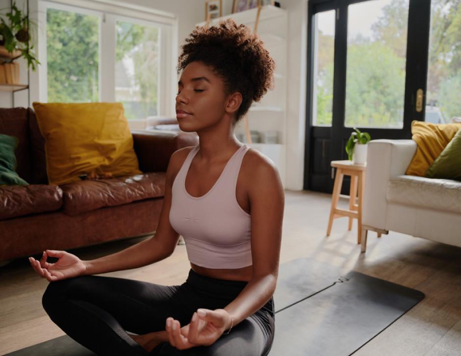 Yoga, African American woman, living room