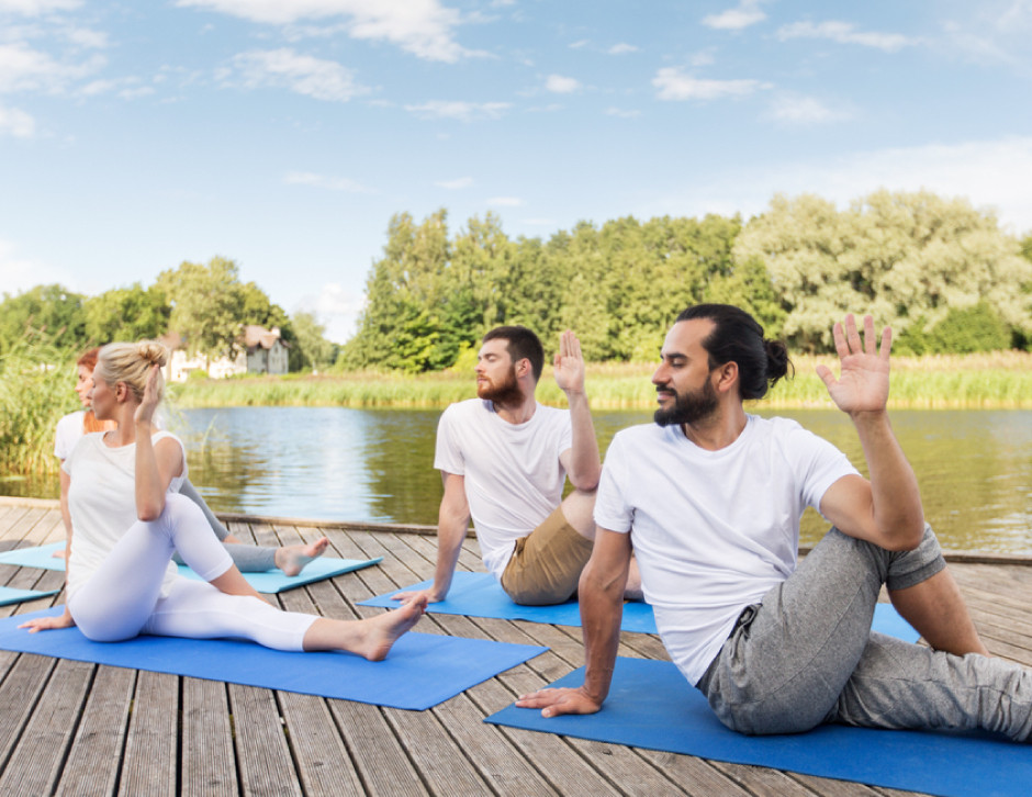 yoga, fitness, healthy lifestyle, group of people, half lord of the fishes pose, outdoors, river