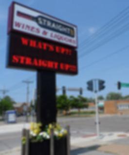 The straight up sign on the corner of Washington and Elmwood.