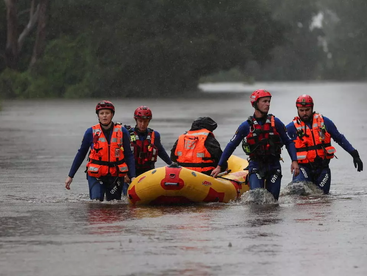 Australia floods claim the first fatality, more evacuations as clean-up begins