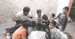 Anupam Pande Gurpal Singh Teaching Children. Stambh.jpg