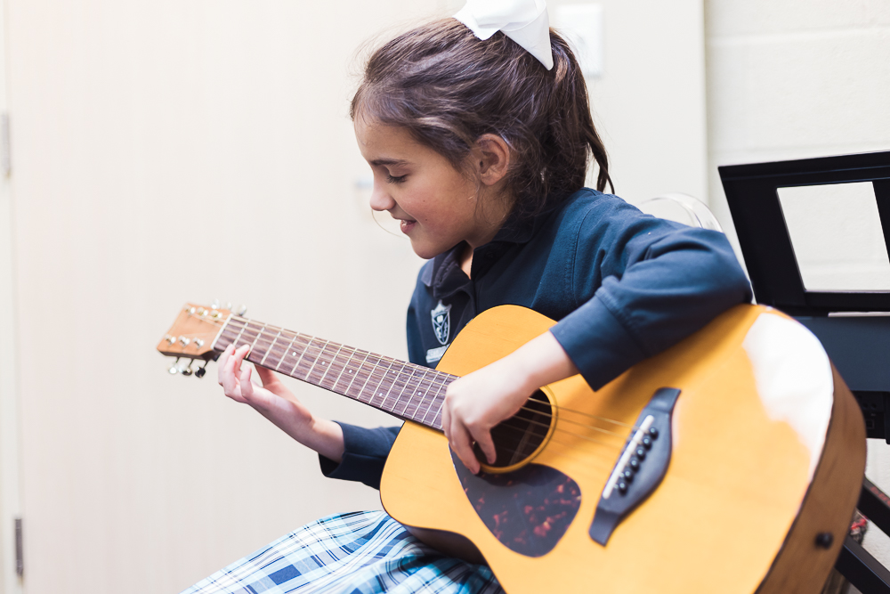Student in guitar lesson