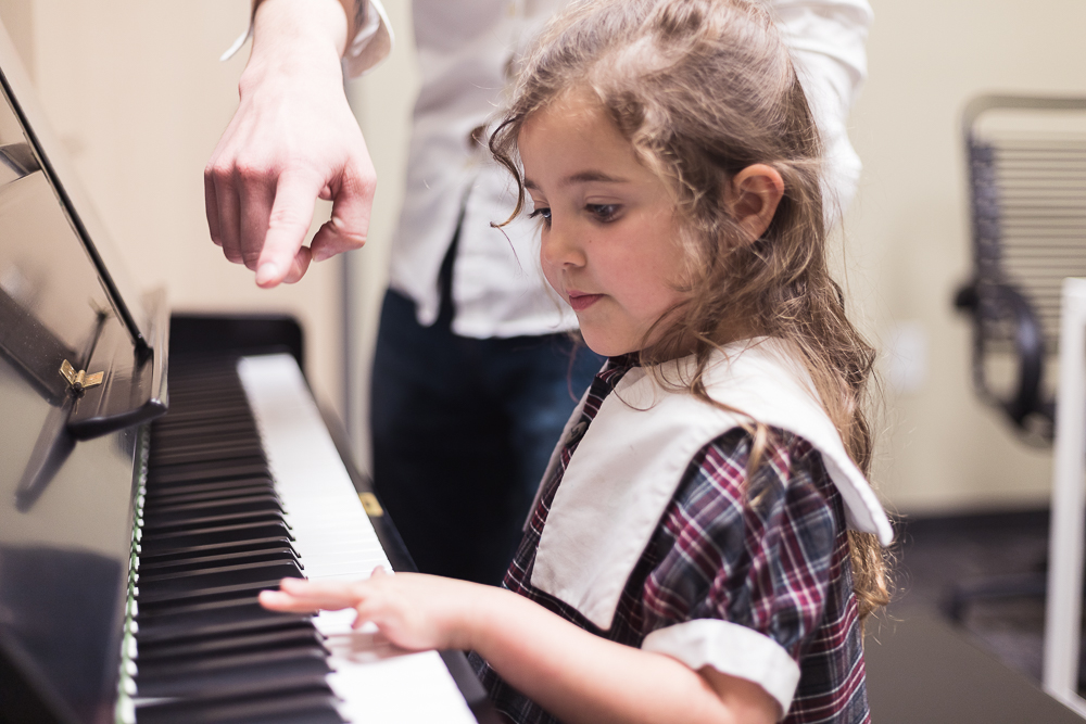 Teacher and student in piano lesson