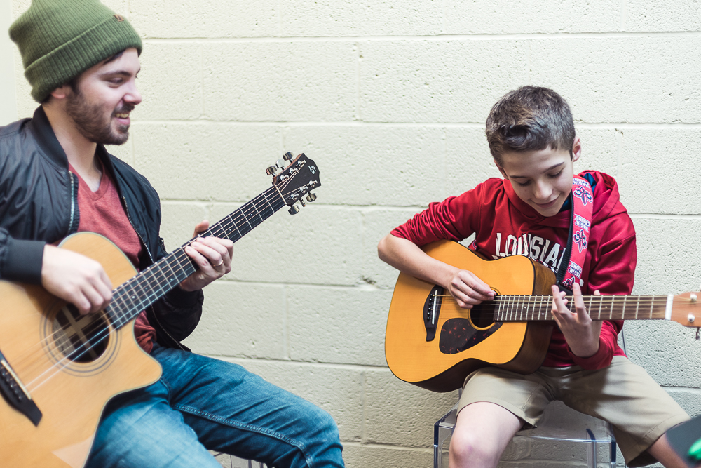 Student and teacher in guitar lesson