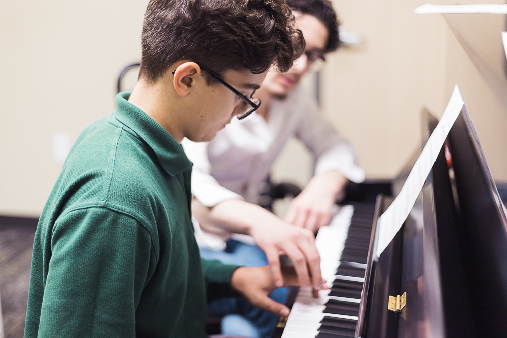Student and teacher in piano lesson