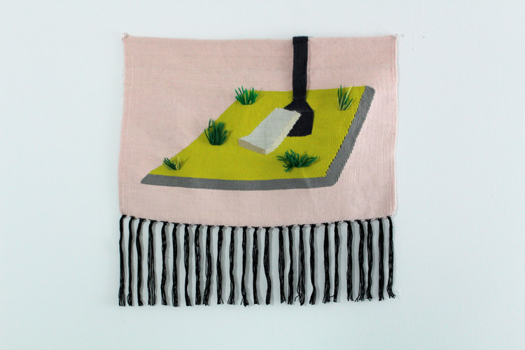 A grassy island with daffodils and a couch cushion