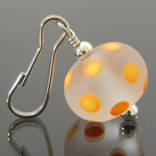 zipper pull etched clear with orange and yellow polka dots side view