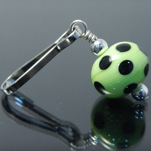 handmade zipper pull lime green with black polka dots side view