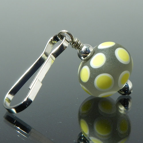 handmade zipper pull etched gray with yellow polka dots side view