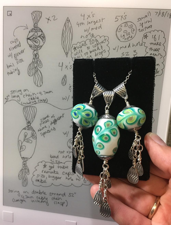handmade silver metal clay and lampwork glass pendants