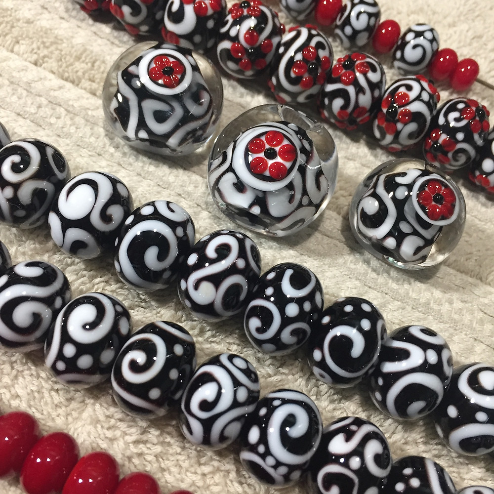 black, red and white handmade lampwork glass beads