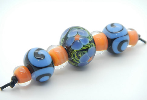 lampwork glass bead set black, green, purple, flowers and spirals set of 7 round beads