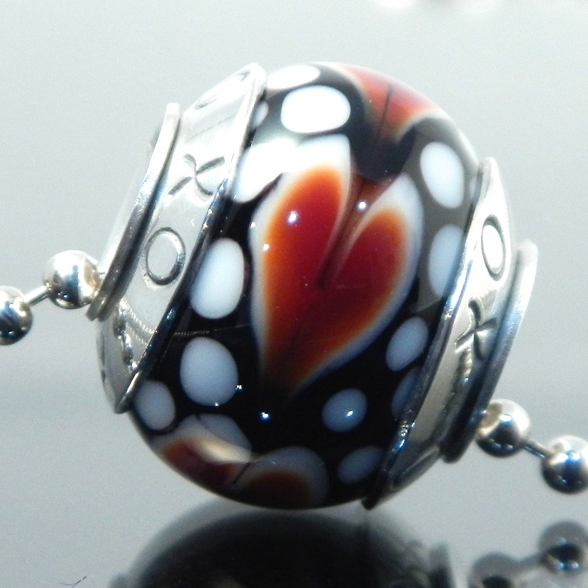 Hand stamped heart bead