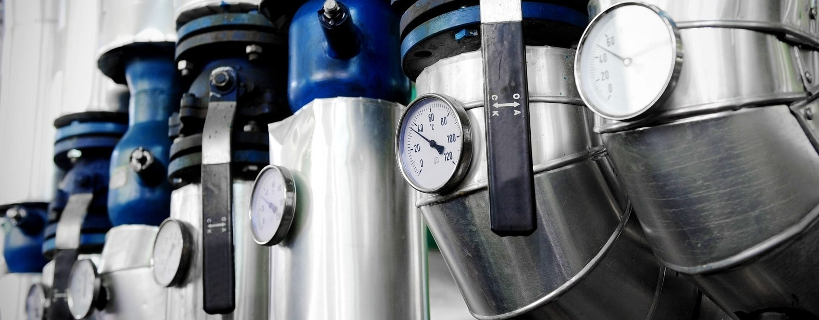 Commercial heating and plumbing pipework with isolation valves, lever valves and temperature gauges