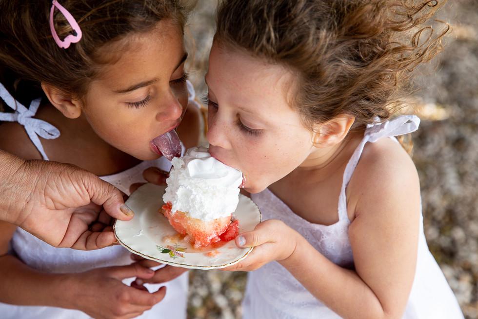 Two Girls eating Sabrina cake