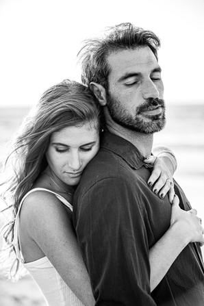 A couple hug on the beach