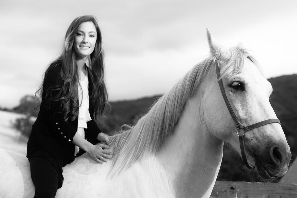 Woman riding a white horse B&W