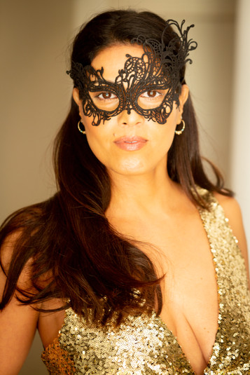A woman in a masquerade mask