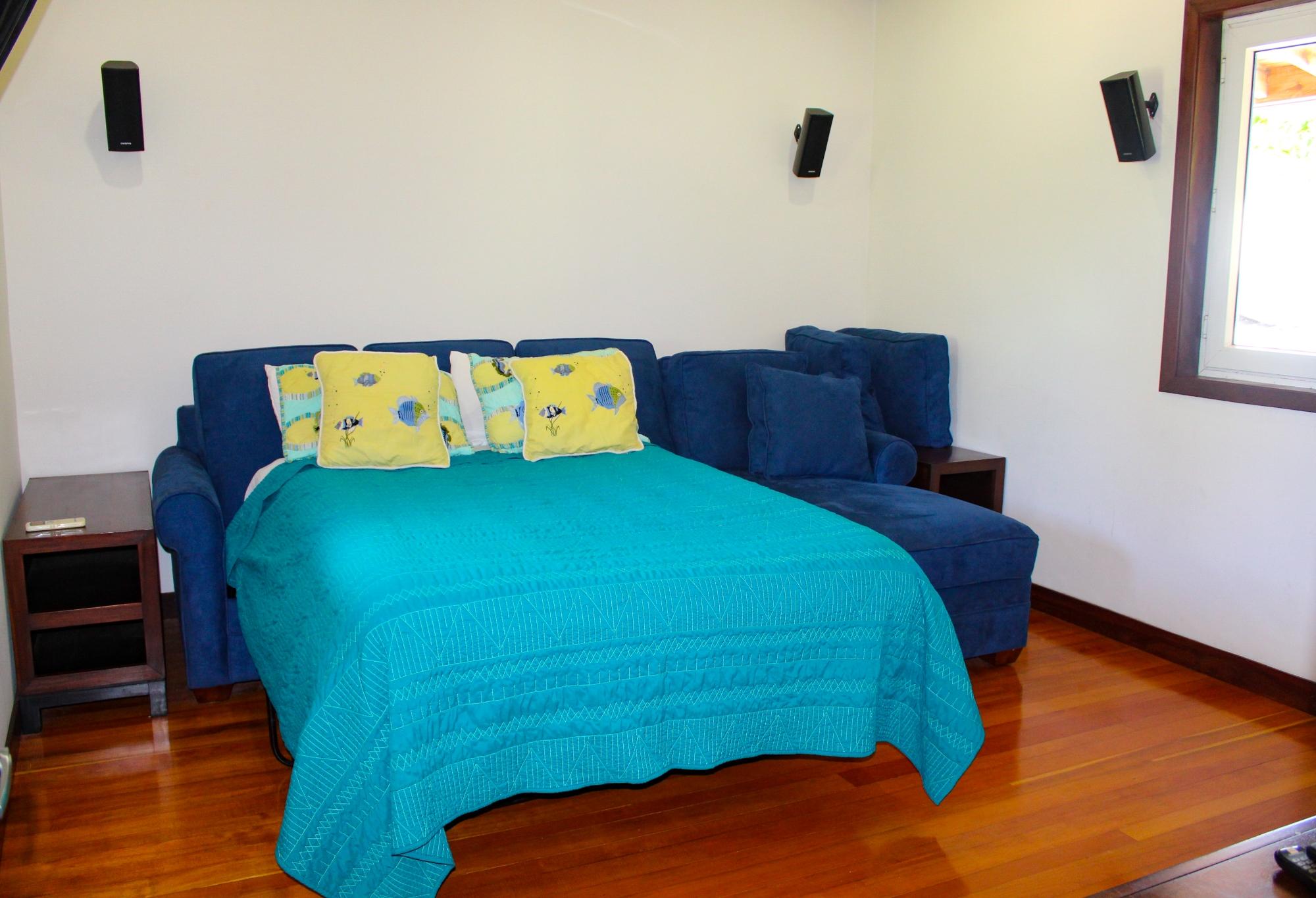 Queen bed in media room
