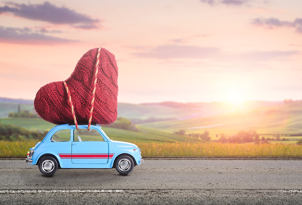 Blue retro toy car delivering heart for