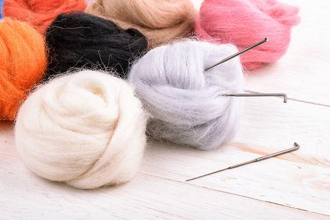 Close up of wool needle felting kit on w