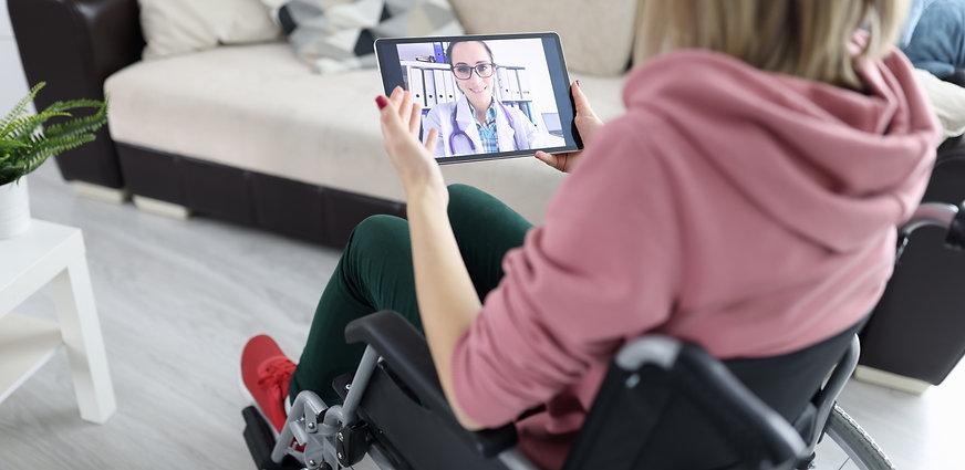 Women in a wheelchair talking on video call_edited.jpg