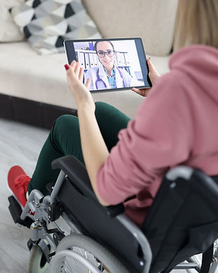Woman in a wheelchair talking on video call