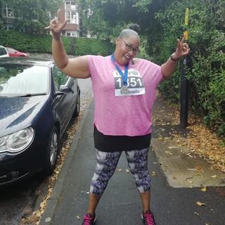 Zabrina with her Fun Run medal