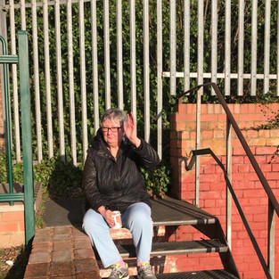 Christine one of our FAB volunteers enjoying the sun outside while the young people played basket ball.
