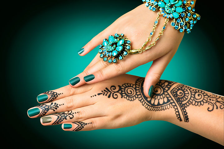 Woman Hands with black mehndi tattoo. Hands of Indian bride girl with black henna tattoos. Hand with