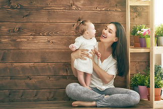 Happy loving family. Mother and her child baby girl playing in the summer day. .jpg