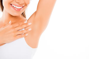 Close Up Of  Happy Young Woman Showing Her Smooth Armpit.jpg
