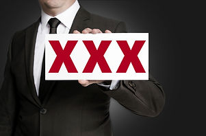 Xxx Sign Is Held By Businessman Background.jpg