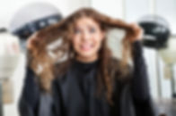 Frustrated young woman pulling her hair in beauty salon.jpg