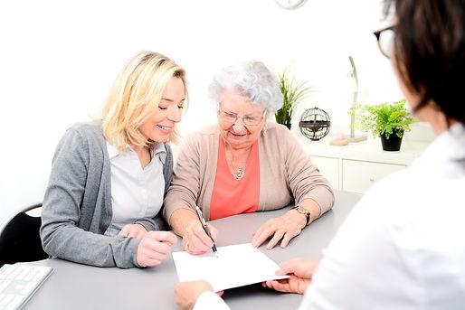 elderly senior woman with daughter signa