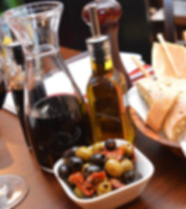 olives, bread, olive oil, balsamic oil, pepper