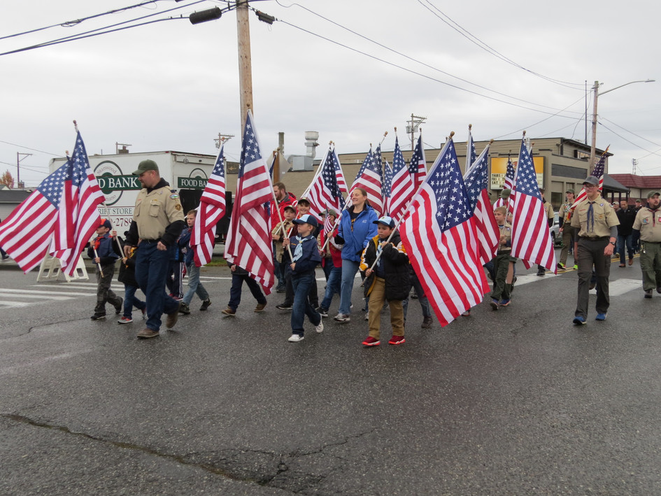 Troop 46 Cub & Boy Scouts carry flags
