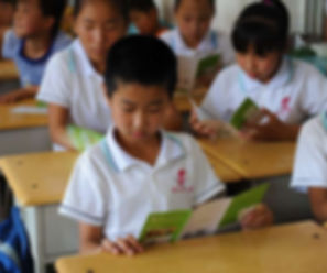 Kid Looking at BEST Brochure in Shanxi
