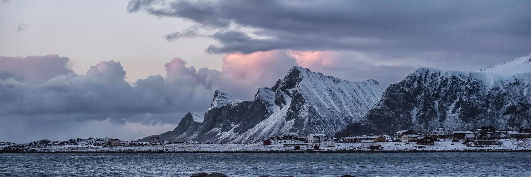 rocky-mountain-near-body-of-water-under-