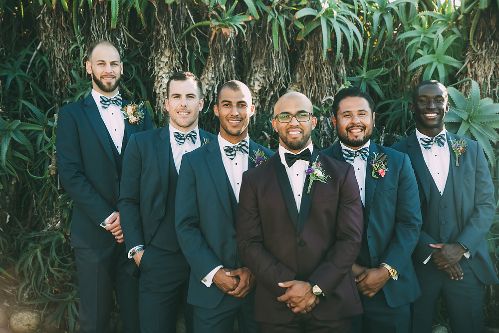 groomsmen suits and bow ties